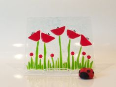 REd FLowers Fused Glass ARt Panel   A field of red Flowers under a blue sky that never fades.   I hand cut and layered each piece of glass to create this panel. The bright red is a happy color and the green is the perfect accompaniment.   Easy to display in any space.   Measures: 6 1/2 x 5 3/4 without the stand  **Multiple Item Shipping Discount ** I am happy to combine shipping charges, please send me a note with your choices and I will send you a quick quote, or purchase your desired items...