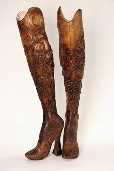 A photo of the legs created for Aimee Mullins by the late fashion designer Alexander McQueen. The basic functional legs, with the sockets, were carved per McQueen's directives from solid ash by Bob Watts at Dorset Orthopaedic in the United Kingdom, and then the finished carvings were done in London by McQueen's team. Mullins wore these in McQueen's runway show in September 1998, shifting the conversation about prosthetics and design.