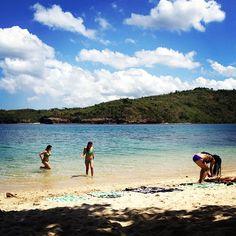 Enjoying the cool waters of Club Punta Fuego's beach.
