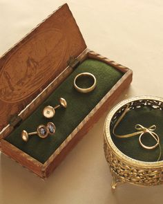 If you envision his-and-her ring boxes, curate a pair by giving them matching components. To transport their wedding bands, both from Catbird in Brooklyn, and the groom's locket cuff links, this couple lined antique boxes with the same green velvet material.