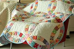 love her fabrics in this wedding ring quilt