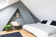 Real home: remodelling a loft-style maisonette This exposed brick wall, painted in Farrow & Ball's 'Downpipe', creates a striking focal poin Small Loft Bedroom, Attic Bedroom Designs, Loft Room, Loft Bedroom Decor, Brick Bedroom, Loft Bedrooms, Bedroom Ideas, Bedroom Rustic, Bedroom Lighting