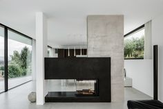 The Triangle House by Philipp Architekten Triangle House, Freestanding Fireplace, Limestone Flooring, Villa, Cozy Fireplace, Pool Designs, Living Room Modern, Ground Floor, Luxury Homes
