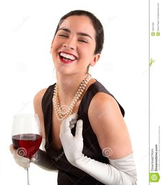 Woman Holding Champagne | beautiful woman is holding a glass of wine and laughing.