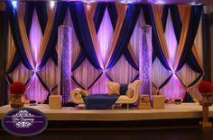 Love the way these curtains are draped and tied. Different from typical stage decors