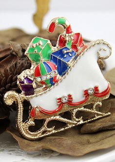 White Christmas Sleigh Brooch Filled w Packages, Bulb, & Candy Cane.