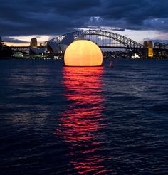 The enormous 12m high inflatable sun is a prop in Madama Butterfly, an outdoor opera performed on a temporary stage built on Australia's mos...