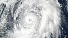 A mammoth typhoon has struck Japan, hurling dangerous winds and threatening to cause major flooding and mudslides.