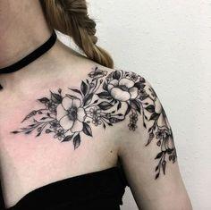 Blackwork florals on shoulder by Vlada Shevchenko