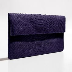 Dark purple python clutch by Verinosa The exquisite timeless elegance of deep purple python clutch makes it a smart addition to every fashion savvy wardrobe. Carry it to make a subtle statement about your style and team it with your favorite jeans for a signature look.Designer Colour: Dark PurpleGenuine Python snakeskin: IndonesiaInterior: Suede lining and debossed designer letteringMagnetic-fastening front flapAvailable with and without removable chain strapDimensions: 26.5cm x 15cmNote…