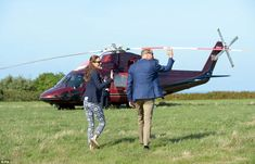 William and Kate give a final wave as they head back to the chopper following their visit to the island of St Martin's