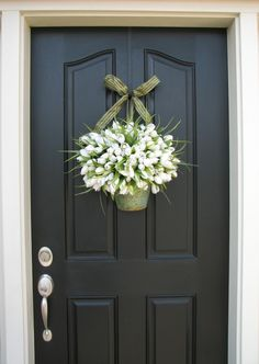 I love the looks of a black front door with flowers - so crisp!