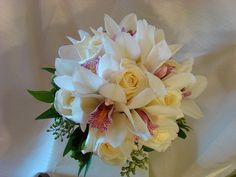 Looking for a nice Rose and Orchid bouquet.  This one seems nice