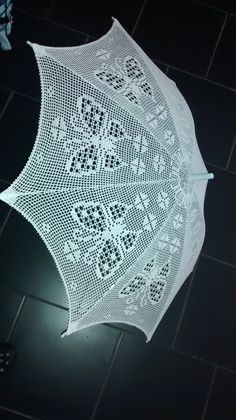 crochet umbrella- gorgeous and completely NOT functional design... too many holes. I ♥ butterflies, though...