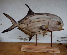 Driftwood Permit sculpture by Tony and Shaun Fredriksson Alphones island Seychelles