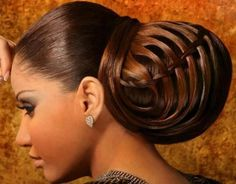 Massive chignon updo hairstyle with intricate designs