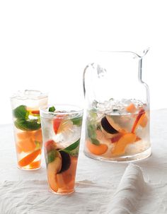 Summer Fruit Sangria   In a pitcher/lg.bowl, combine 6 c fruit (mango, pineapple, cantaloupe, apricot, etc), sliced /cut into pieces, 1/4 c thinly sliced peeled fresh ginger, 1 to 1/2 c fresh basil or mint leaves, & 1/2 c orange-flavored liqueur. Mash gently with back of wooden spoon until basil is bruised and fruit releases juices. Add 750ml bottle chilled dry white wine Sauvignon Blanc / Pinot Grigio, & 3 Tbsp. fresh lemon juice. Stir & combine. Chill 1 hr, up to 1 day. Add ice before serving.