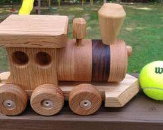 Train set wooden 6 car Handmade red oak mahogany and walnut. Heirloom Quality Beautifully hand finished. Ships Monday Dec. 11th.