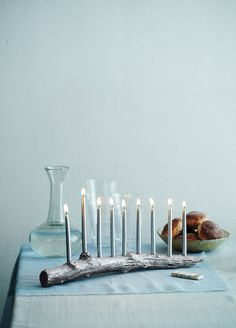 Find a branch at least 16 inches long, with a raised knot (for the shamash, the candle used to light the other candles).  Mark nine evenly spaced dots with a pencil, one on top of the knot; drill holes with a 3⁄8-inch bit. (Hole size depends on candle size.)  Paint it with craft paint. Let it dry, and affix self-adhesive bumpers to the bottom, if desired.