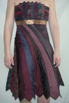 I've seen variations on this idea before, and they always entrance me.  I like the way the shape of a tie naturally makes the dress get wider towards the hips.  The back of this dress is so cool I'm going to pin it separately.