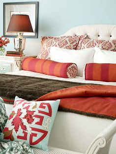 Like the pale blue wall with the raspberry/orange pillows