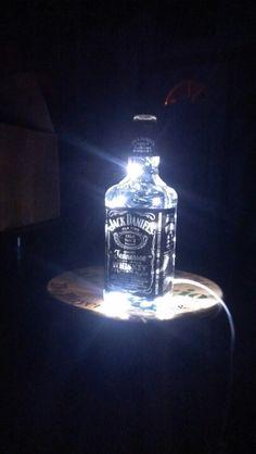 Just need someone to donate bottles! Liquor or wine bottles string lights Rum Bottle, Bottle Vase, Whiskey Bottle, Bottle Lamps, Alcohol Bottles, Liquor Bottles, Glass Bottles, Beer Decorations, Light Decorations