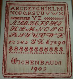Sampler from 1903.  Red wool on cotton.  Treated and later framed by Spicer Art Conservation.  From a private collection.