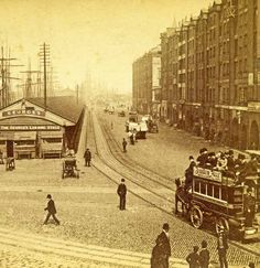 Georges-Dock 1891 horse drawn wagons trundle down the dock road with their heavy loads. The Goree warehouses with their arcades are on the right hand side (sadly demolished after the war) Liverpool Town, Liverpool Docks, Liverpool History, Liverpool England, Liverpool Waterfront, Victorian London, Victorian Era, Old Street, England And Scotland
