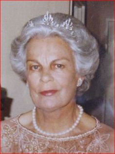 Princess Caroline of Liechtenstein, nee Ledebur-Wicheln, wearing her wedding tiara, designed as a series of three open-work palmettes, centered on a natural button pearl and using button pearls as spacers.