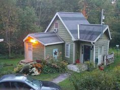 Small Cottage House - designed by owner.  [Notes to self: no drywall, just wood.  Nice window & door placement in pic #4.  Not a fan of the painted parts - too contrasty for my taste - plain stained wood would be nicer IMO.]