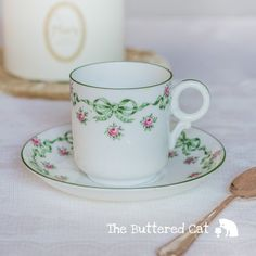 Very pretty antique bows and roses demitasse cup and saucer, for the collector