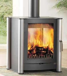 Firebelly Double-sided Stove from Firebelly wood burning stoves range. Buy a Contemporary Firebelly stove at best price from authorised Firebelly retailers Wood Burning Logs, Modern Wood Burning Stoves, Wood Stoves, Gas Log Burner, Wood Burner, Double Sided Log Burner, Wood Fuel, Multi Fuel Stove