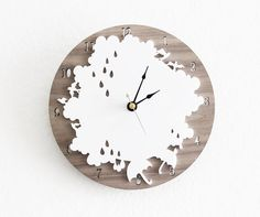 This crazy cool clock is not only charming but incorporates laser cut wood, which we love! #walldecor