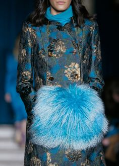 The Matthew Williamson Teal Ornate Brocade Double Breasted Coat as seen on the catwalk during London Fashion Week. Click to get the look.