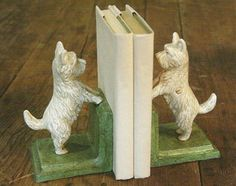 These sweet little white West Highland Terriers show off their lively nature on these decorative bookends. Made of sturdy cast iron, the Westie Bookends make a charming accent for your bedside table or home library. The Westie Bookends feature an antiqued, weathered white finish on sage green stands and hand painted details on each dog.