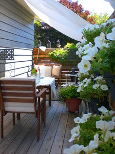 Exotic and brightly decorated outdoor setting in white with gorgeous flowers