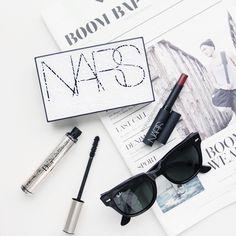 makeup + sunnies over magazine