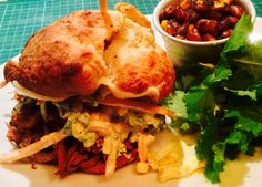 Pulled pork in chipotle ketchup & beer, served on a Buttermilk biscuit with corn slaw (white & red cabbage, carrot, sweet corn in Mayo & mustard & cream). Served with kale salad and baked beans (borlotti beans in bacon jam, chipotle ketchup, beer & red onion).
