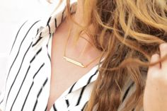 This CC Skye stacked bar necklace is the perfect way to polish off any look.