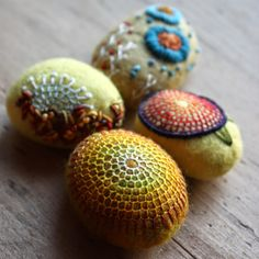 I always love Lisa Jordan's embroidered & felted stones, but this time I am intrigued with the honeycomb-like pattern on the middle one - lil fish studios felted stones