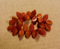 SALE 12X7X3MM Czech Glass Leaf Beads In Opaque Brown With Translucent Red Sold In Lots Of 25 Pieces