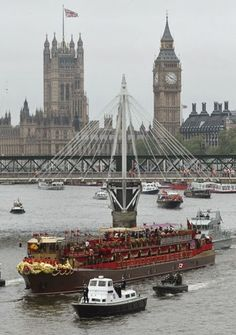The Royal Barge as it sails up The River Thames - London