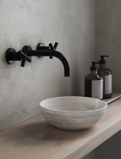 The beautiful Frama store in Copenhagen, housed in the former home of the St. Pauls Pharmacy. Minimal bathroom ideas, black taps and marble sink. Image: cate st hill
