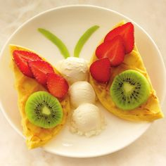 Butterfly Recipe Desserts with Kellogg's® Eggo® Homestyle Waffles, strawberries, kiwi fruits, kiwi fruits, Breyers® French Vanilla Ice Cream Cute Snacks, Cute Food, Good Food, Yummy Food, Baby Food Recipes, Cooking Recipes, Food Art For Kids, Food Decoration, Food Crafts