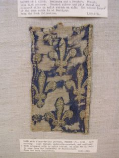 embroidered band. Fleur De Lis, 13-14th C. underside couched silk threads on silk twill