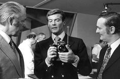 """Roger Moore with a Nikon celebritycameraclub: """" Roger Moore (as James Bond) with his camera rocket launcher from the 1974 film The Man With the Golden Gun. Looks like it's a Nikon F. Roger Moore, James Bond Gadgets, James Bond Actors, Nikon F2, Bond Issue, British Accent, Celebrity Photos, The Man, Cool Photos"""