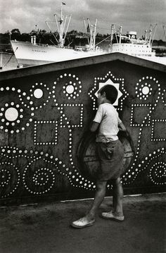 Marc Riboud is a French photographer with over 60 years of experience under his well-notched belt. Riboud first began experimenting with his father's Marc Riboud, North Vietnam, Vietnam War, Bratislava, Famous Portraits, Dove Men, War Image, French Photographers, Angkor