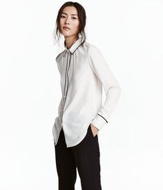 Check this out! Long-sleeved blouse in woven fabric with covered buttons at cuffs and a gently rounded hem. Contrasting trim at collar, cuffs, and on placket. - Visit hm.com to see more.