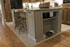 This island was designed specifically for the clients dogs (Belka & Shiner). We incorporated an area for their food bowls that could be used as a bookcase in the future.  We also did a cabinet with  double pullout bins for dog food.