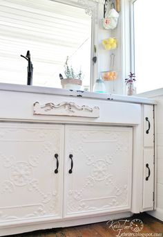 Knick of Time: Antique Ceiling Tile Cabinet Doors - what a lovely idea! Loving the detail.